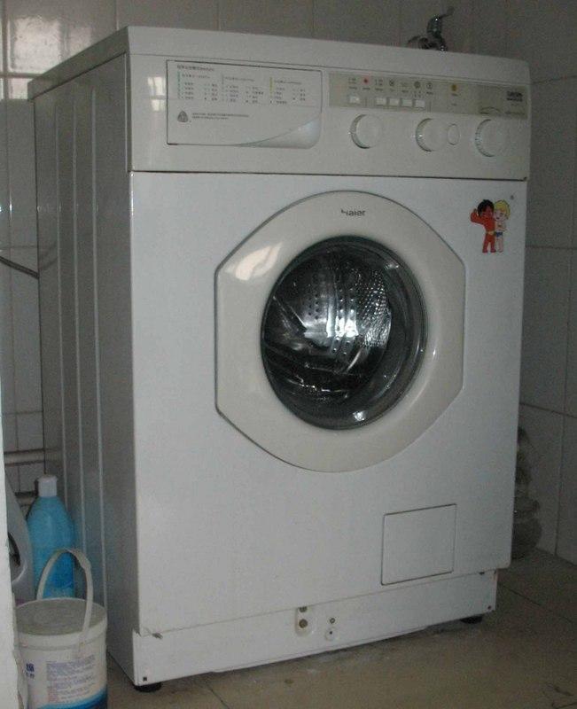 海尔品牌全自动滚筒烘干洗衣机