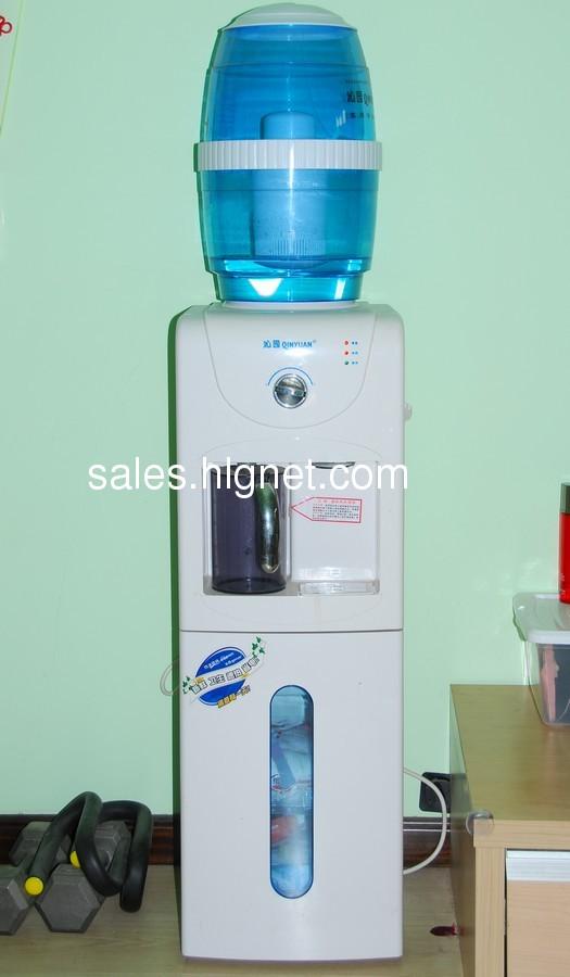 转让九成新沁园速热型饮水机带净水器消毒柜